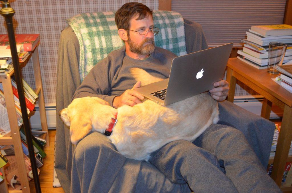 Millie on Steve's lap
